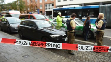 Police guard the area at Rosenheimer Platz square in Munich, Germany.