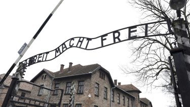 """German Nazi concentration camp Auschwitz in Oswiecim. The sign reads """"Arbeit macht frei"""" (Work makes you free)."""
