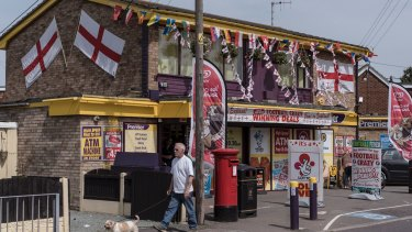 Flags of England and other nations competing in the UEFA European Championship decorate a convenience store in Canvey Island, England, June 10, 2016.