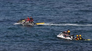 Jet-skis search waters off Botany for Tim Nguyen.