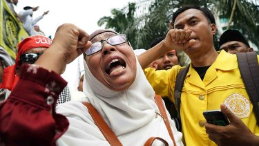Anti-Ahok protester expresses her distress after he was jailed for two years rather than the maximum of five.