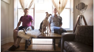 Marco Pugnaloni, left, with Paul Jewson with their dogs Cloe and Oscar. Both have an apartment they run through Airbnb in St Kilda and are doing very well from the business
