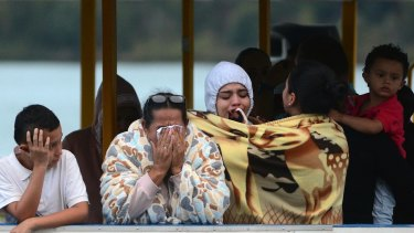 People who survived the capsizing of a ferry wait for more information about their missing friends and relatives.