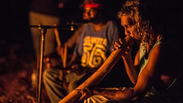 Bart Willoughby plays didgeridoo during an intimate concert at Frog Hollow community.