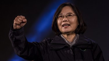 Tsai Ing-wen waves to supporters during a rally campaign ahead of the Taiwanese presidential election.