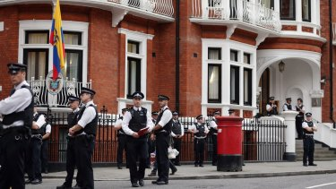 Police stand guard outside the embassy where the founder of WikiLeaks is staying.