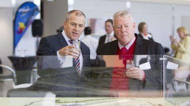 Wagners chairman John Wagner and QantasLink CEO John Gissing look at a model of the new Brisbane West Wellcamp Airport.