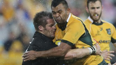 No inch given: Richie McCaw and Kurtley Beale leave their mark in 2014.