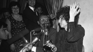 Bob Dylan gestures during a news conference in Paris in 1966.
