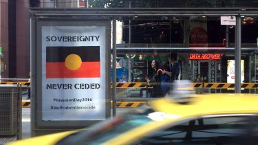 One of the anti-Australia Day posters outside Southern Cross Station on Spencer Street.