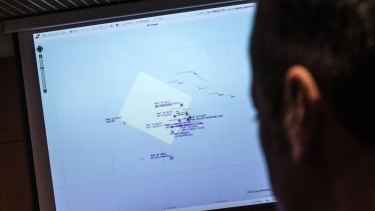 An Italian coast guard officer using a monitor showing the ships navigating the area where the boat believed to be crowded with perhaps as many as 700 migrants capsized in the waters north of Libya on the weekend.
