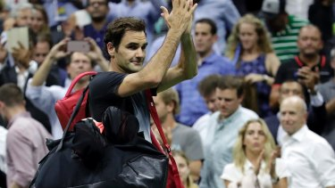 Captivating even when he doesn't win: Roger Federer leaves the court after losing to Juan Martin del Potro in the US Open.