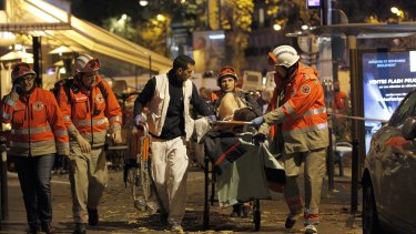 An injured person is evacuated from the Bataclan theatre.