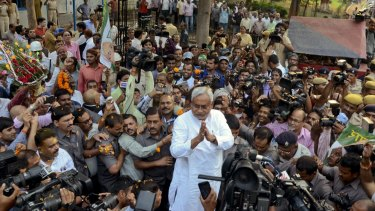 Bihar Chief Minister Nitish Kumar, centre, surrounded by media earlier this month.