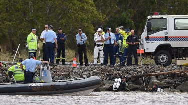 Two police divers at the accident scene on the Tweed River.