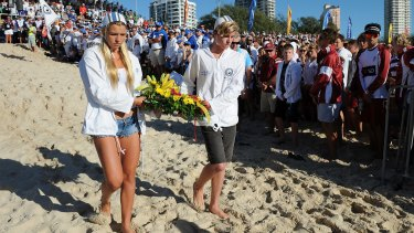 A memorial service is held for Matthew Barclay at Kurrawa Beach, on the Gold Coast.