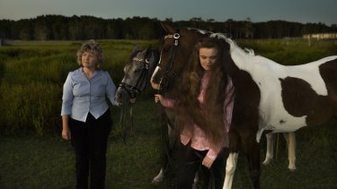 Kim-Leanne King, with her youngest daughter Madeline and their Appaloosa horses, worries she exposed her children to poison in the Williamtown area.