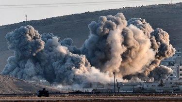 Smoke rises during air strikes on Kobane seen from the Turkish-Syrian border.