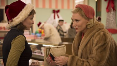 Rooney Mara (left) as Therese Belivet and Cate Blanchett as Carol Aird in <i>Carol</i>.