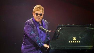 Elton John's performs in concert.