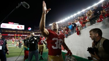 Jarryd Hayne #38 of the San Francisco 49ers walks off the field after their NFL preseason game against the San Diego Chargers at Levi's Stadium in Santa Clara, California.