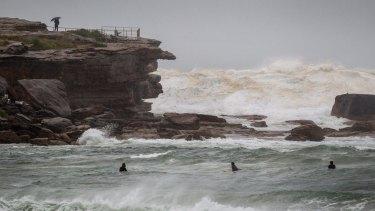 Surfers brave the dangerous surf in Bondi.