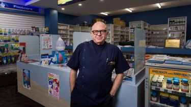 Solly Lew at his chemist in St Kilda. Chemist Warehouse has moved in next door.