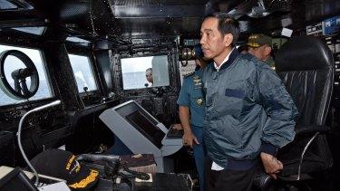Indonesian President Joko Widodo on the bridge of navy warship KRI Imam Bonjol in the waters of the Natuna Islands in June.