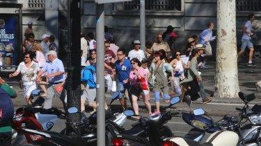 People flee in terror after the Barcelona van attack.