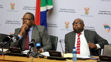 South African Police Minister Nathi Nhleko (left) and Public Works Minister Thulas Nxesi brief the media on the president's Nkandla homestead project on May 28.