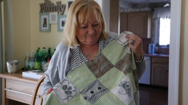 Teri Kroll holds her 'Timmy Blanket', made from scraps of her dead son's clothes.