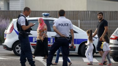 Police officers investigate an attack on a church that left a priest dead in Saint-Etienne-du-Rouvray.