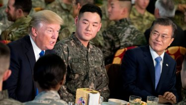 Trump and South Korean President Moon Jae-in, right, have lunch with US and South Korean troops.