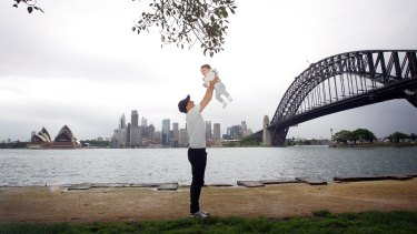 Sensitive city: Peter Tsigolis and his one-year-old son Orlando take in the Sydney Harbour experience from the shore.