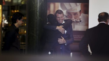 NSW Premier Mike Baird visits the Martin Place Lindt Store as it opens for the first time since December.