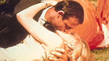 Sean Connery as James Bond, and Honor Blackman as Pussy Galore, in the 1964 movie <i>Goldfinger</i>.