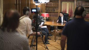 Greece's Prime Minister Alexis Tsipras interviewed by a television journalist on Tuesday.
