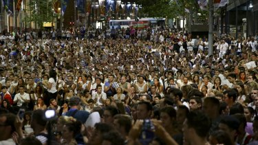 A massive crowd converges to pay tribute to the Paris victims in Martin Place.