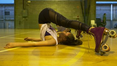 A Rollerfit participant stretches during a workout.