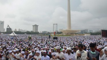 Tens of thousands take part in a prayer at Jakarta's National Monument during the December 2 rally against Jakarta's governor Ahok.