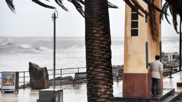 A man shelters from the winds near Brighton Jetty, Adelaide.
