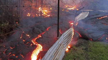 A fence won't cut it: Lava flows from the Kilauea volcano onto properties in Hawaii.