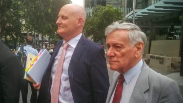 Former South Australian Education Minister Donald Hopgood and his legal representative Anthony Kimmins.