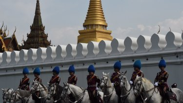 Palace guards outside the Grand Palace in Bangkok waiting for the body of Thailand's King Bhumibol Adulyadej on Friday.