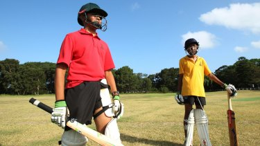 On their guard: Young players Aroon Patha and Akash Yousuf practise at Centennial Park.
