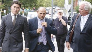 Not guilty plea: Hazem El Masri, centre, arrives at Bankstown Local Court last October.