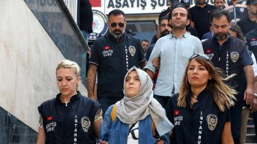Police escort journalists to court in Istanbul on Friday. Twenty-one journalists were appearing in court after being detained as part of a sweeping crackdown following Turkey's failed military coup.