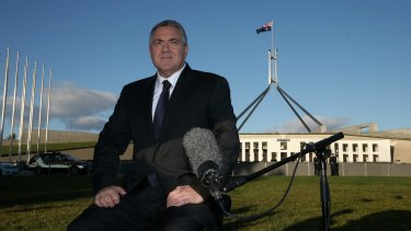 Treasurer Joe Hockey in between breakfast tv interviews on the front lawn of Parliament House in Canberra on Wednesday 13 May 2015. Photo: Alex Ellinghausen
