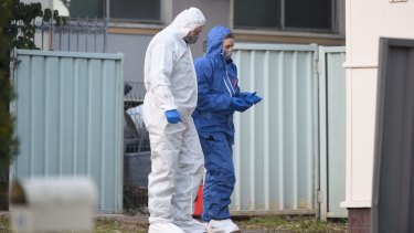 Forensic police examine the scene of the shooting.