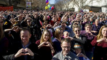 Canberrans, including Samantha and Hayley Wilson (third and fifth from left), at the Love in Canberra rally for marriage equality.